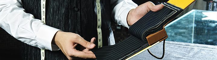 Bespoke Tailor Selecting Fabrics 718x200