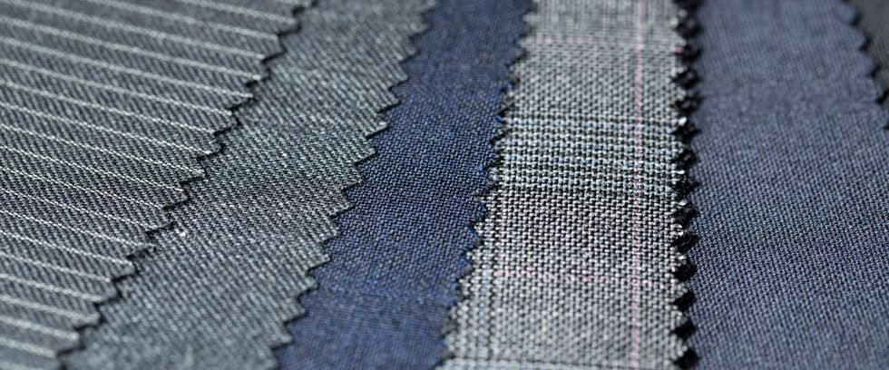 choosing suit fabric by swatch navy grey patterns detail